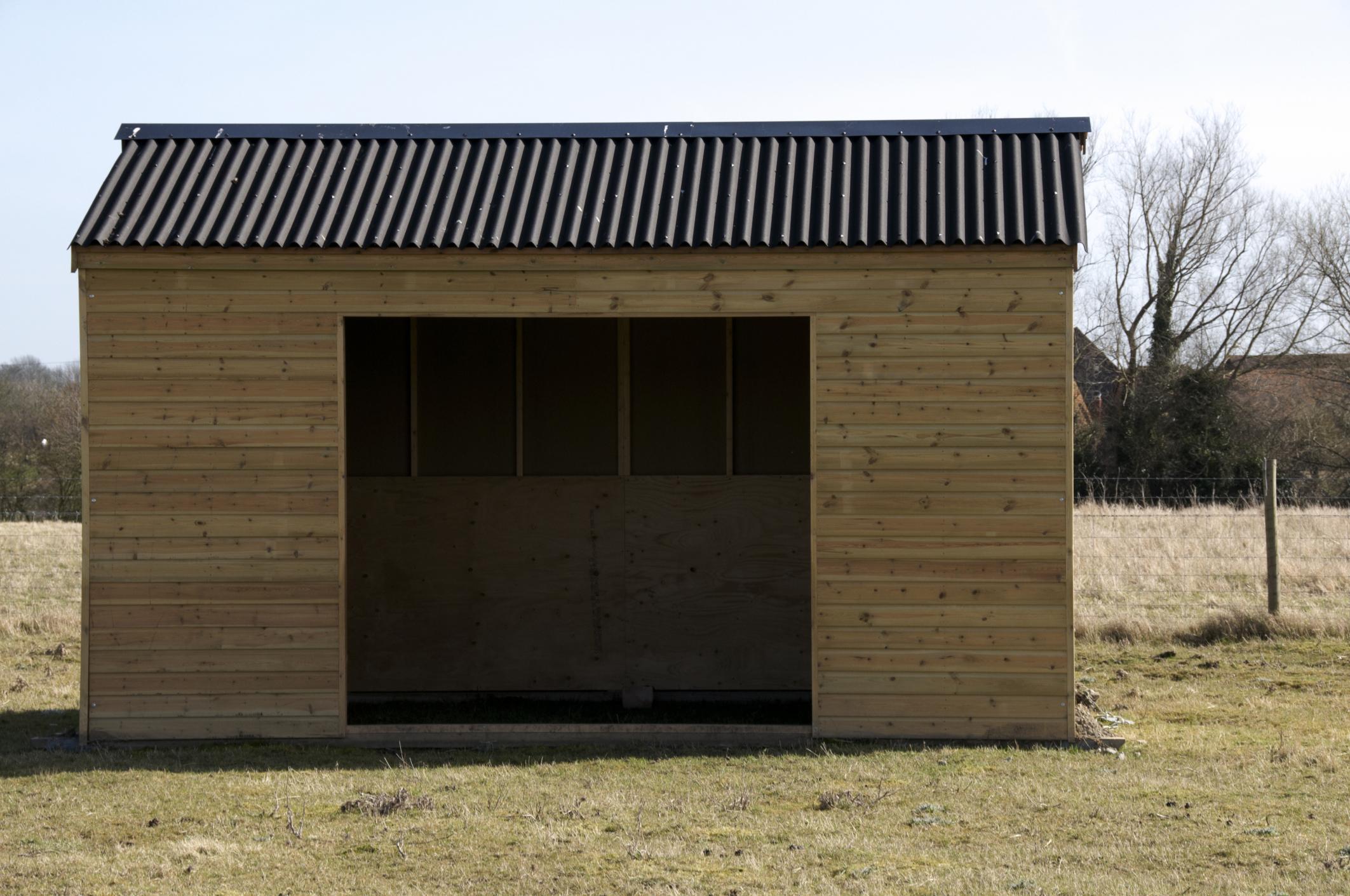 Custom wooden storage shed being built on a farm near Springfield Virginia