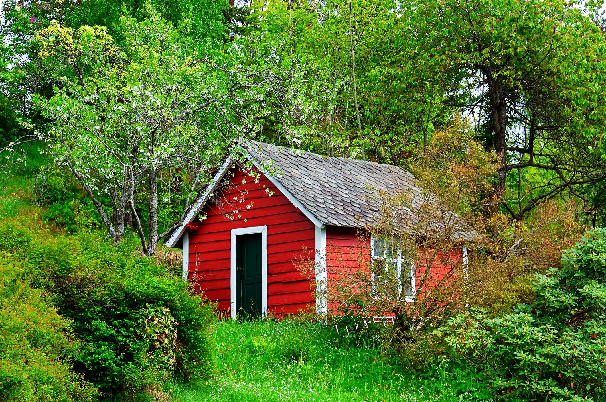 Red and white wooden garden shed for storage